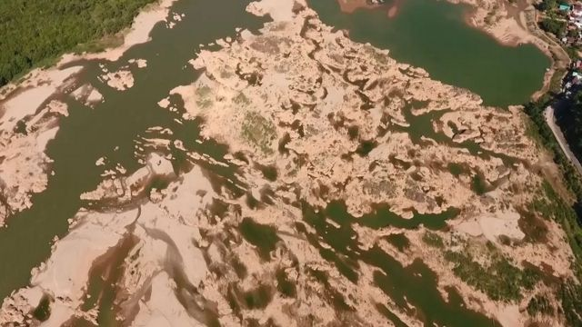 This screengrab from an aerial video taken on October 28, 2019 shows the Mekong river in Sungkom district in Nong Khai province, more than 300km from the Xayaburi dam