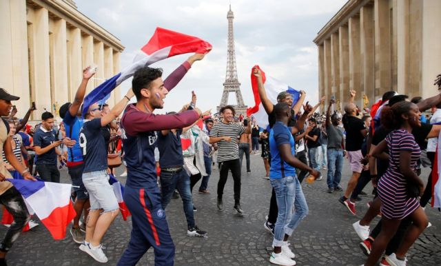 French fans in Paris celebrate in front of the Eiffel Tower, 15 July 2018