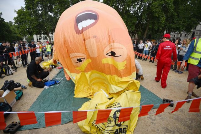 "A ""Baby Trump"" balloon is inflated in London's Parliament Square"