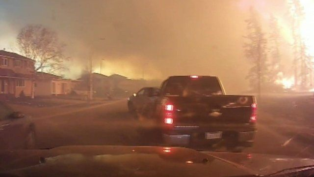 Truck and wildfire in Canada