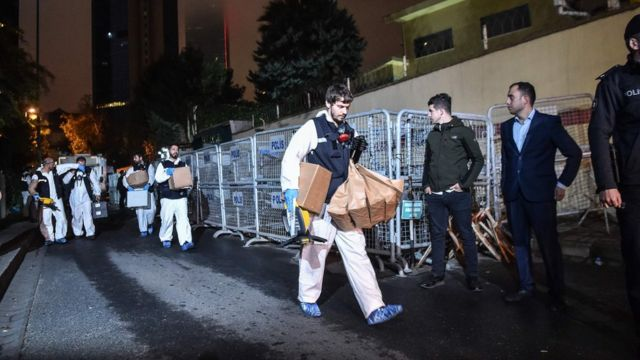Turkish forensic police officers leave after searching evidence at the Saudi Arabiain Consulate on October 18, 2018 in Istanbul.