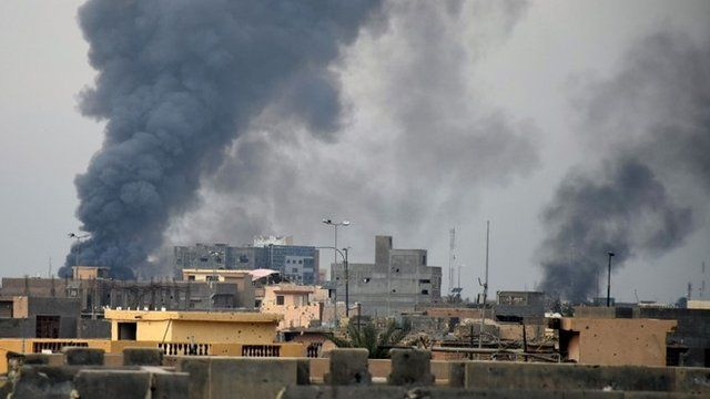 Smoke rises from Islamic State positions following a U.S.-led coalition airstrike as Iraqi Security forces advance their position in downtown Ramadi