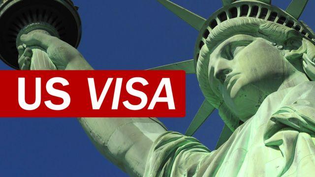 página web para vistos americanos mostra imagem da estátua da liberdade e o nome US Visa