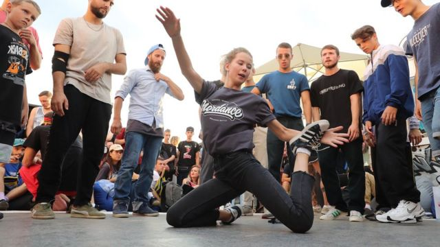 A woman breakdances at a festival in Moscow's Gorky Park