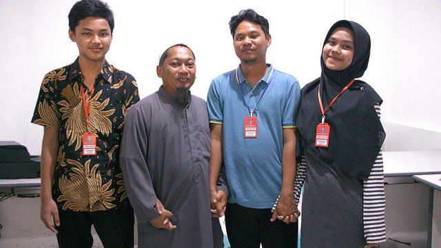 Rizqy, Hassan, Iwan and Sarah hold hands