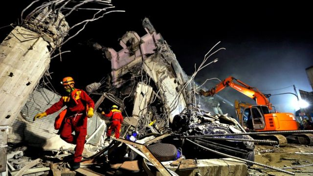 Rescuers remove debris as they continue to search for survivors from a collapsed building following a 6.4 magnitude earthquake struck the area in Tainan City, south Taiwan, Taiwan, 06 February