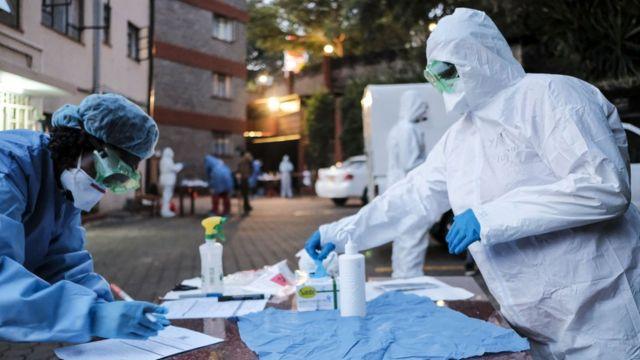 Doctors prepare to administer the mandatory Covid-19 coronavirus test for detainees of a government designated quarantine facility in Nairobi