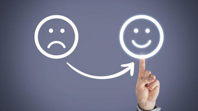 Símbolos de rosto feliz e triste