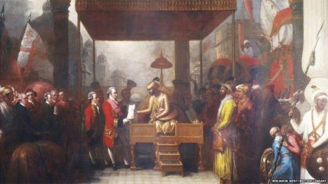 मुग़ल बादशाह शाह आलम द्वितीय ईस्ट इंडिया कंपनी के अधिकारी लॉर्ड क्लाइव को बंगाल का संपूर्ण दीवानी अधिकार सौंपते हुए.