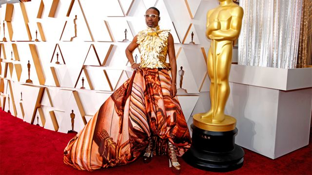 Billy Porter on the red carpet wearing a dress