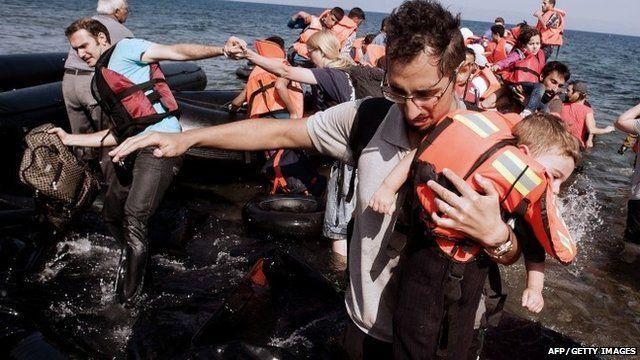 Refugees and migrants arrive on Eftalou beach, west of the port of Mytilene, on the Greek island of Lesbos