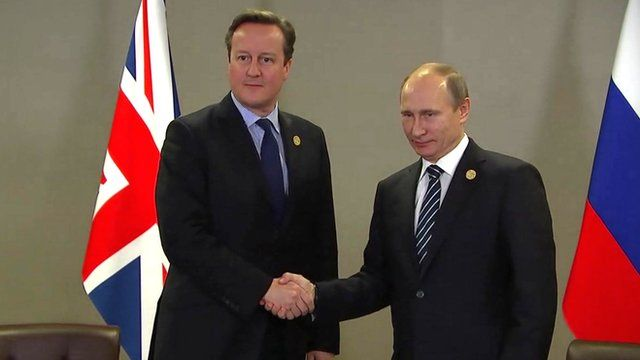 Prime Minister David Cameron and Russian President Vladimir Putin shaking hands