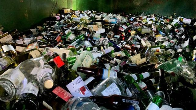 A bin full of empty bottles