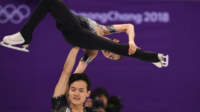 North Korea's Kim Ju Sik and North Korea's Ryom Tae Ok (top) compete in the pair skating short program