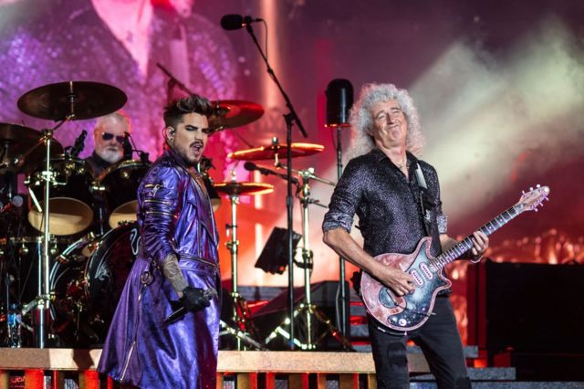 Роджер Тейлор, Адам Ламберт и Брайан Мэй на концерте Queen в рамках Rhapsody Tour в городе Брисбейн в Австралии. 13 февраля 2020 г.