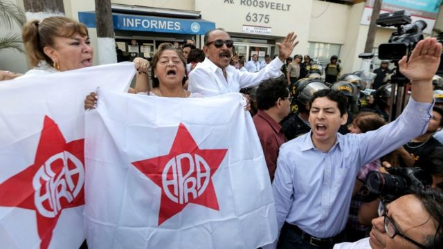 Supporters of the Peruvian ex-president Alan Garcia gather outside the Casimiro Ulloa Emergency Hospital in Lima. 17 April 2019