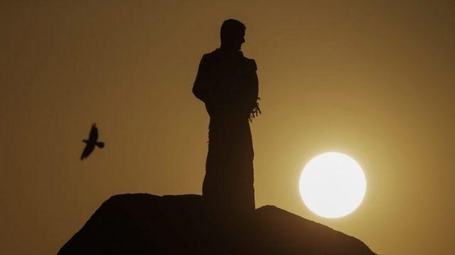 A pilgrim prays at Mount Arafat (Mount of Mercy), during the Hajj pilgrimage (11 September 2016)