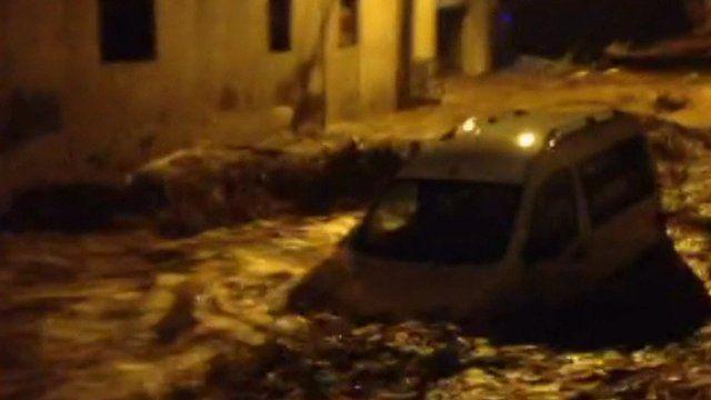 Van washed away in floods