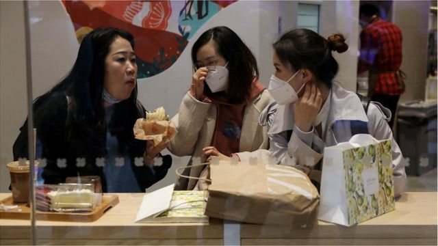 People dine inside a restaurant at a newly opened shopping mall in Beijing, China April 16, 2021.