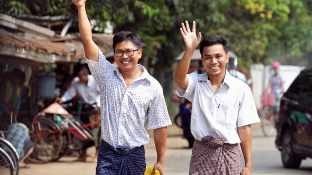 Reuters reporters Wa Lone and Kyaw Soe Oo gesture as they walk free outside Insein prison after receiving a presidential pardon in Yangon, Myanmar