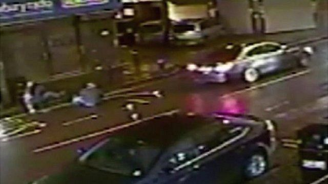 CCTV image of two men after they were hit by car