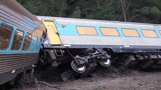 The derailed carriages of a passenger train that was travelling from Sydney to Melbourne, Australia