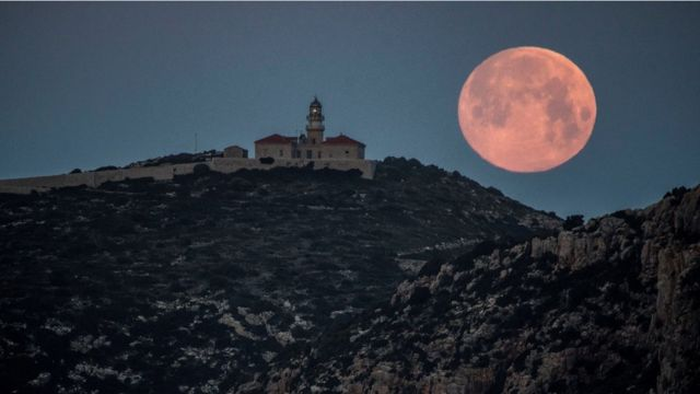 View of the Blue Moon from the village of Sant Elm, in Majorca Island, eastern Spain, early 31 March 2018.