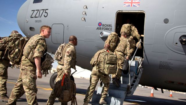 British troops board a RAF C-17 as they leave Afghanistan to go home at Kandahar airfield in 2014