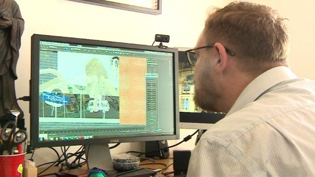 Animator watches his computer rendering a sequence