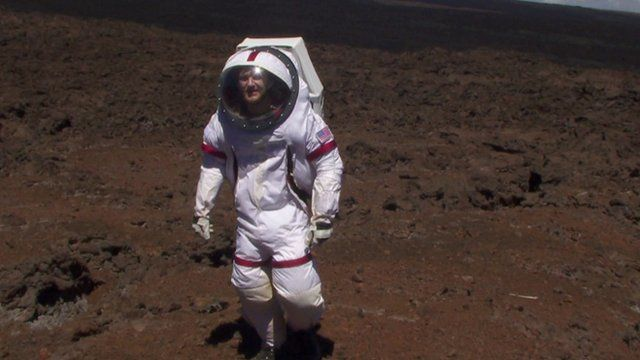 Scientist in spacesuit