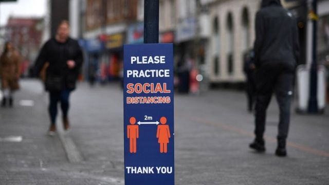 please practice social distancing sign