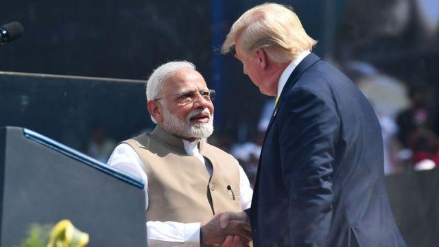 Donald Trump and Narendra Modi shaking hands at the Motera stadium in Gujarat