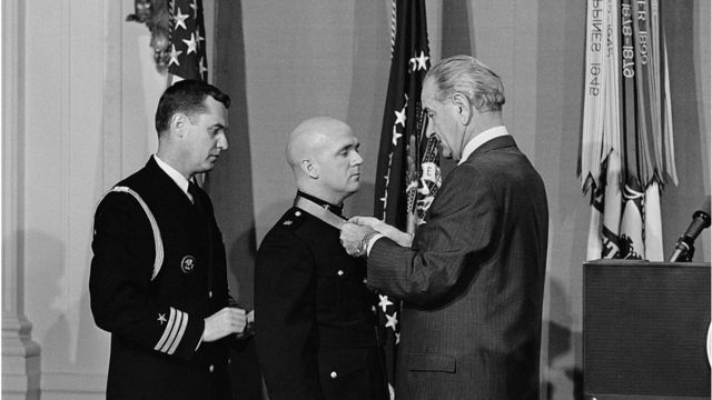 President Johnson confers the Medal of Honor o­n U.S. Marine Corps Major J. Modrzejewski of Annapolis, Maryland in White House ceremonies March 12. The award was made to Major Modrzejewski for heroism in Vietnam during 1966.