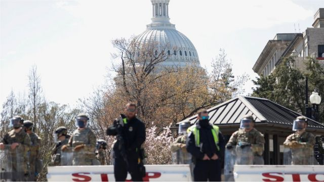 Members of the National Guard stand along a perimeter near the Supreme Court, following a security threat at the U.S. Capitol, in Washington, U.S., April 2, 2021.