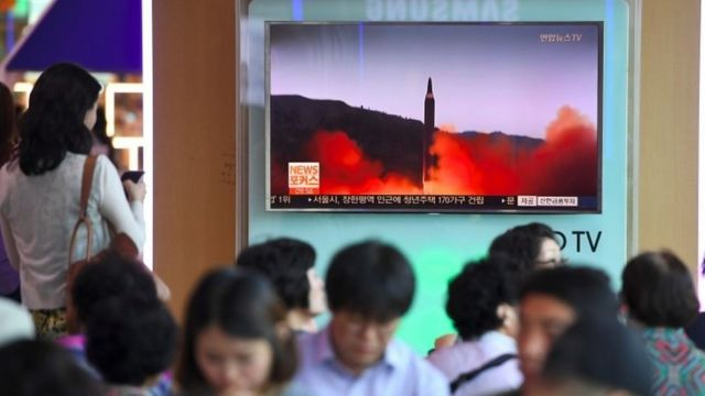 People in Seoul watch a news report about the missile launch (15 Sept 2017)