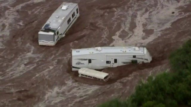 Motor homes surrounded by floodwater