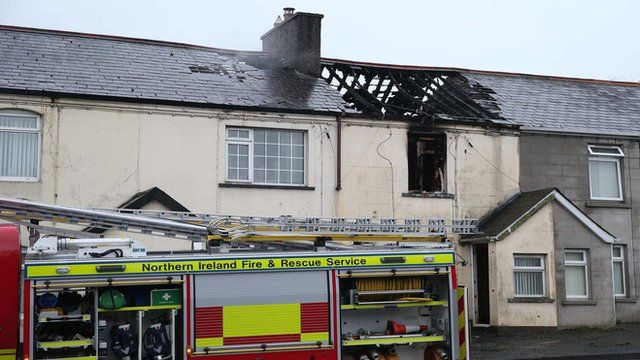 A fire engine outside one of the damaged houses in Castlewellan