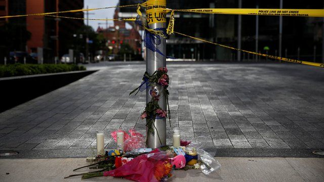 A makeshift memorial is seen near the crime scene two days after five police officers were killed in Dallas, Texas, U.S., July 9, 2016