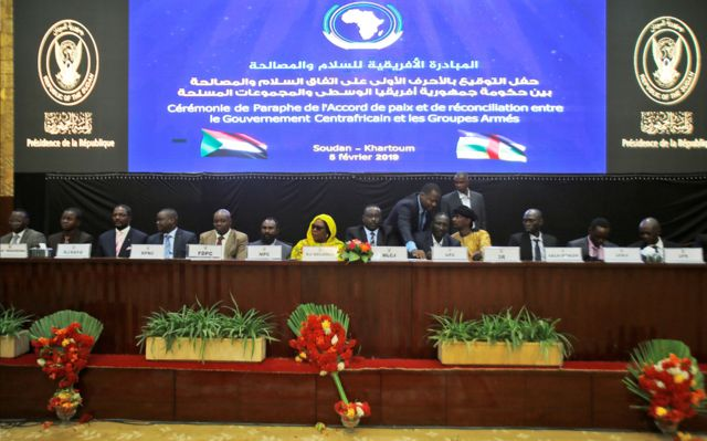 Central African armed groups leaders attend the inking of a peace deal in Khartoum on February 05, 2019. - The government of the Central African Republic and 14 armed groups on February 05 inked a new peace accord seeking to end years-long fighting that has left thousands of people dead. The accord was initialled by President Touadera for the CAR government and representatives of militias which control most of the chronically-troubled country.