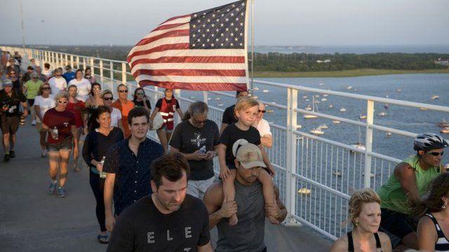 People marching on a bridge in Charleston, South Carolina