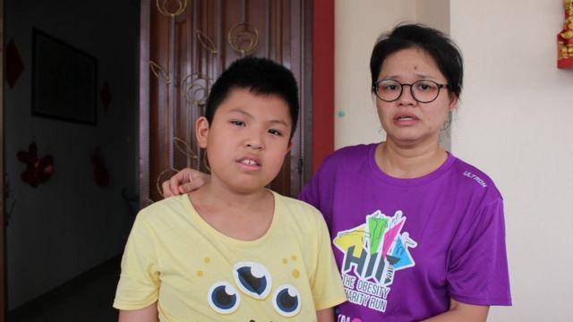 Belle Tan e o filho