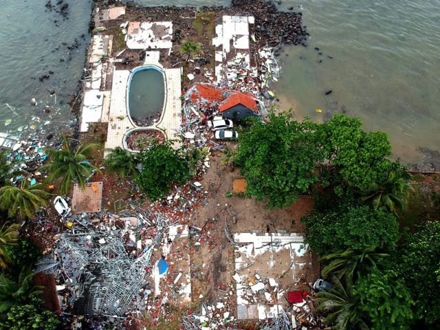 An aerial photo shows damaged buildings in Carita on December 23, 2018, after the area was hit by a tsunami on December 22 following an eruption of the Anak Krakatoa volcano.
