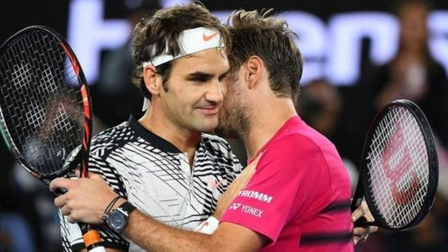 Les suisses Federer (G) et Wawrinka (D)