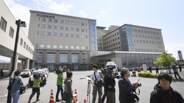 Media gather outside the hospital where the boy has been taken in Hakodate, Hokkaido (3 June 2016)