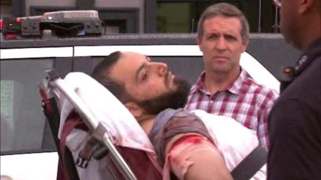 Ahmad Khan Rahami on stretcher in image from video by WABC (19 September)