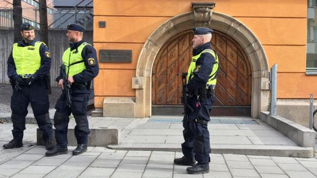 Swedish police standing guard outside the court
