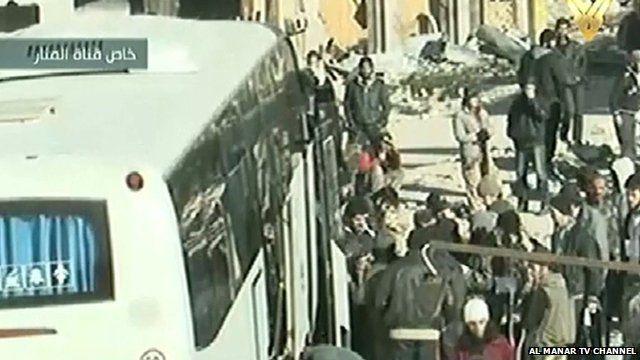 Lebanon's Al Manar TV shows people boarding the buses