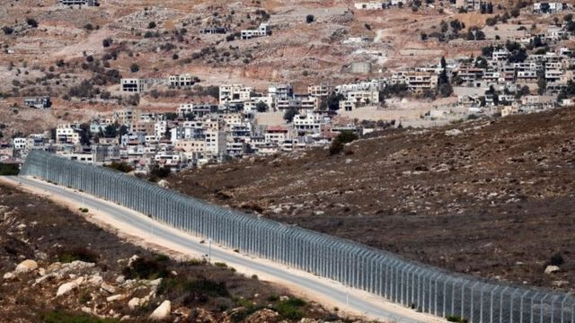 Israeli security fence separates the Israeli occupied sector of Golan Heights (right) from Syria