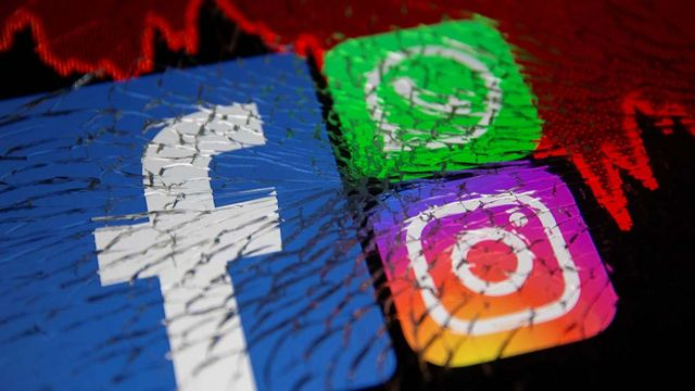 Facebook, Whatsapp and Instagram logos and stock graph are displayed through broken glass