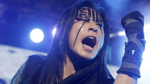 Freddy Lim, a candidate to the 2016 legislative election and singer of death metal band Chthonic, performs during a concert to boost his campaign in Taipei, Taiwan, December 26, 2015.
